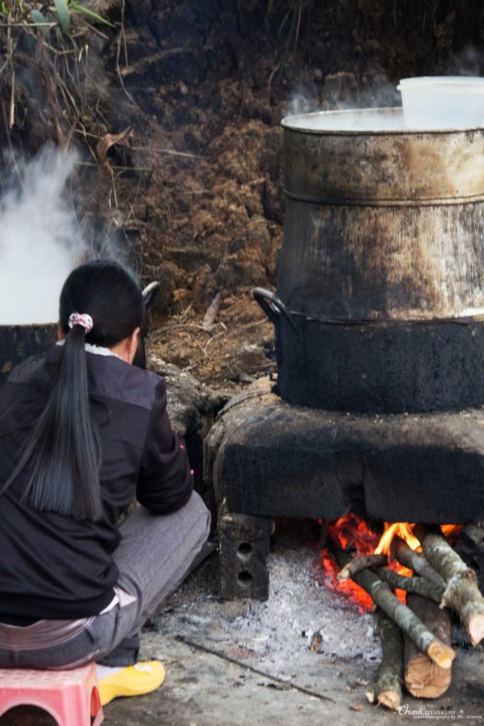 woman boiling food sapa vietnam